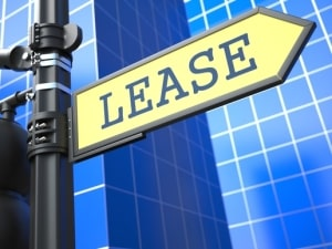 Business Concept. Lease Roadsign Arrow on Blue Background.